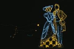 Christmas illumination figures of couple royalty free stock images