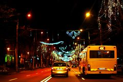 Christmas Street Light In Constanta 2017. Night car  light traffic and street light with christmas theme . a yellow bus and a personal car racing Stock Photography