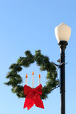 Christmas street lighting. Lamp decoration with wreath and bow Stock Images