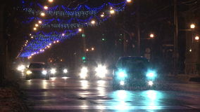 Christmas street lights and traffic in Romania stock video