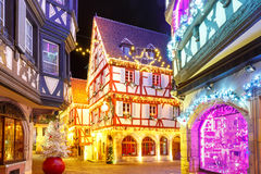 Christmas street at night in Colmar, Alsace, France. Traditional Alsatian half-timbered houses in old town of Colmar, decorated and illuminated at christmas time royalty free stock image