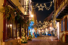 Christmas street at night in Colmar, Alsace, France Royalty Free Stock Image