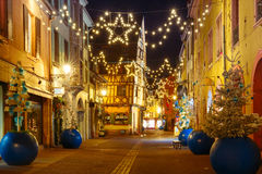 Christmas street at night in Colmar, Alsace, France Royalty Free Stock Photo