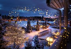 Christmas street snowy winter scenery. Snowy Christmas street magical winter feeling scenery seen from balcony stock photo