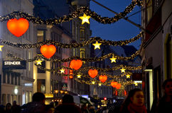 Christmas in the streets of Copenhagen. Christmas in streets of Copenhagen, Denmark, the commercial shopping area Strøget, illuminated by hearts and stars royalty free stock images