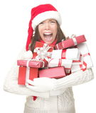 Christmas stress shopping woman. Christmas holidays shopping woman stress. Shopper holding christmas gifts stressed, frustrated and screaming angry. Funny image stock images