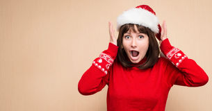 Christmas stress - woman wearing santa hat stressing for christmas shopping with copyspace for your text. Funny image of shouting