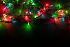 Christmas lights over black background royalty free stock photo
