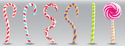 Christmas striped candy in the form of rods and squiggles. Royalty Free Stock Images