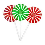 Christmas striped Lollipop set. Spiral sweet candy with stripes. Vector illustration  on a white background. Royalty Free Stock Images