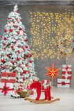 Christmas studio decorations wonderful idea mainly white and red New Year tree with snow and plenty presents under Amazing LED lig Stock Photography