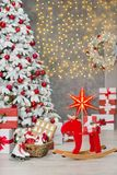 Christmas studio decorations wonderful idea mainly white and red New Year tree with snow and plenty presents under Amazing LED lig Stock Photo