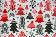 Christmas styled texture ornament with black and red trees. stock photography