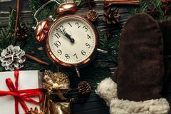 Christmas stylish vintage clock with almost twelve hour and pres royalty free stock photography