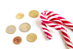 Christmas Sugar Cane Euro Coins. Christmas sugar cane and some Euro coins royalty free stock images