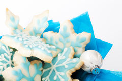 Christmas Sugar Cookies. Snowflake sugar cookies with white and blue icing on a white background stock photography