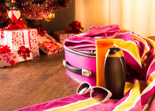 Christmas sun holidays. With colorful luggage, sunglasses and beach accessories Stock Images