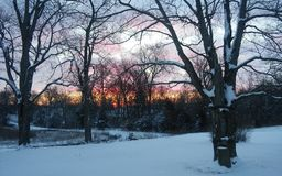 Christmas sunrise in western Indiana. Christmas sunrise with snow cover on the ground in western Indiana royalty free stock image