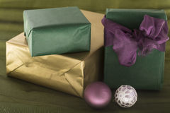 Christmas surprise packages on green background. Xmas surprise package with ornament decorated on green background Stock Photography