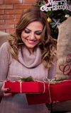 Christmas surprise present!. The girl's happiness about the presents stock images