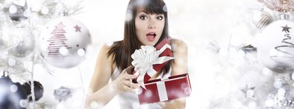 Christmas surprised woman opening gift present box on christmas Stock Photos
