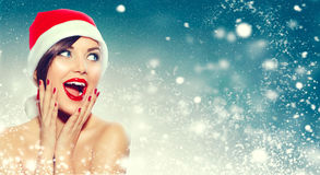 Christmas. Surprised woman in Santa`s hat Stock Photo