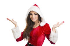 Christmas surprises. Portrait of smiling pretty woman in red Santa Claus costume with hood shrugging against white background Royalty Free Stock Image