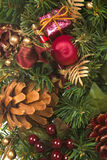 Christmas Swag. With ornaments, pine cones, and ribbons Royalty Free Stock Photo