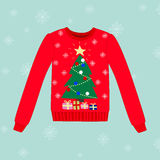 Christmas sweater on blue background with snowflakes Stock Images