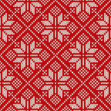 Christmas sweater design on the wool knitted texture. Seamless p Stock Photo