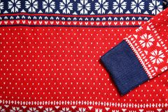 Christmas sweater with pattern as background. Top view. Seasonal clothing stock images