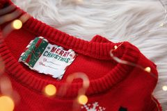 Christmas sweater with tag on fur. Closeup royalty free stock photo
