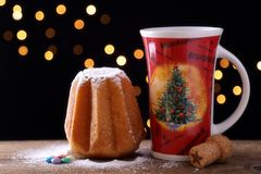 Christmas sweet bread and decorated cup Royalty Free Stock Photos