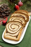 Christmas sweet bread. Sweet bread with nuts and spices on Christmas decorated background Royalty Free Stock Photography