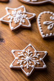 Christmas sweet cakes. Christmas homemade gingerbread cookies on wooden table.  Stock Images