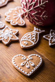 Christmas sweet cakes. Christmas homemade gingerbread cookies on wooden table.  Royalty Free Stock Photo