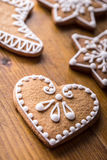 Christmas sweet cakes. Christmas homemade gingerbread cookies on wooden table.  Royalty Free Stock Images