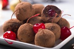 Free Christmas Sweet Candies On The Dessert Table . Chocolate Balls Of Biscuit With Cherry - Loli Pop Or Cake Pop. New Year Decoration Stock Photos - 162621143