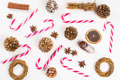 Christmas sweet candy canes and fir cones on white background. Wallpaper Royalty Free Stock Image