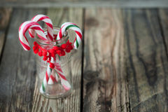 Christmas sweet candys in the glass on the wood background Stock Image