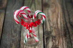 Christmas sweet candys in the glass on the wood background Stock Images