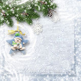 Christmas sweet card for kids. Christmas tenderness background with snowy branches and Christmas decorations with space for greetings and photos Stock Photo
