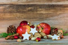 Christmas star cookies, red apples, nuts and spices Royalty Free Stock Photos
