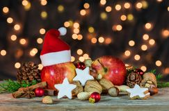 Christmas star cookies, red apples, nuts and spices Stock Images