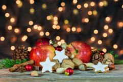 Christmas star cookies, red apples, nuts and spices Royalty Free Stock Photo