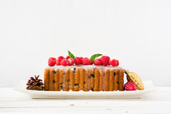 Christmas sweet fruit cake on white wood. Christmas fruit cake on white wood table royalty free stock photo