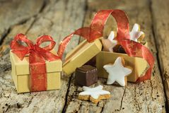 Christmas sweets in gift box with star biscuits and chocolate royalty free stock photos
