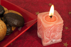 Christmas sweets and candle Stock Photo