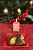Christmas sweets and candle on the table Stock Image