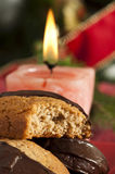 Christmas sweets and candle on the table Royalty Free Stock Images